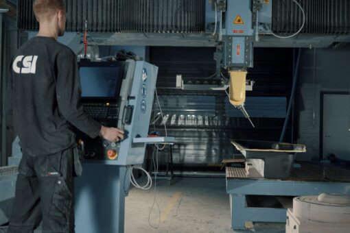 5-axis milling of carbon fibre composite part.